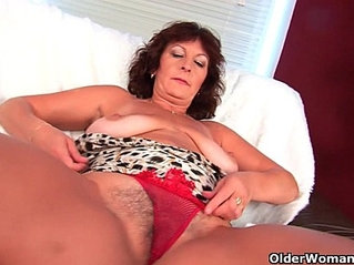 Busty lady Alma rubs her hairy cunt with fingers