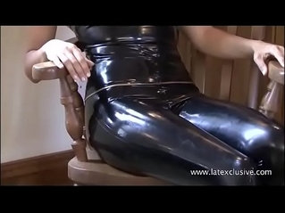 Black latex dress and fetish wear on posing softcore solo model Alyss in pvc rub