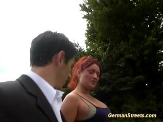 busty redhead in outdoor threesome