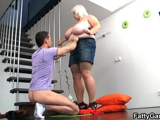 Shooting pics of her huge boobs turns him