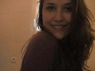 Sexy French chick in bathroom makes a strip tease for you