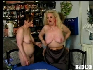Two mature sluts share a large black cock